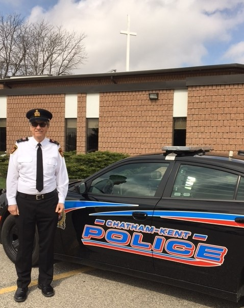 Chaplain with police cruiser